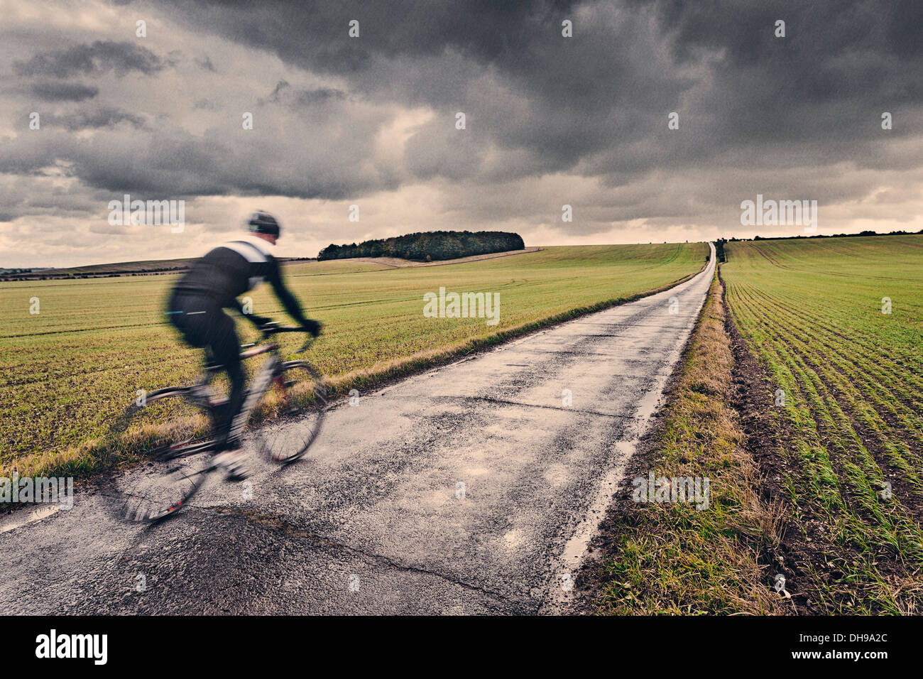 Lone Cyclist in UK Countryside - Stock Image