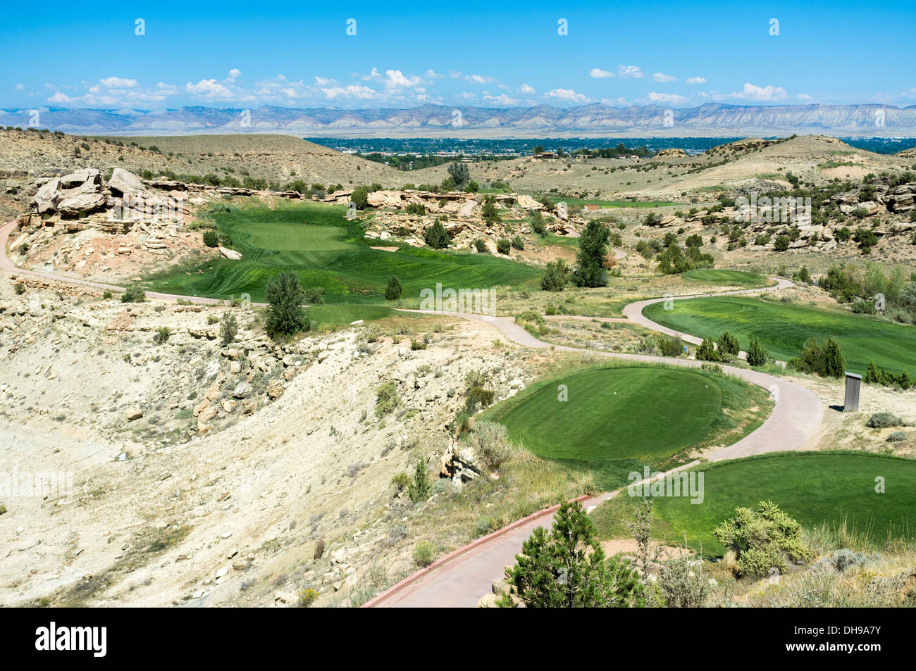 Seventeenth green and fairway at Redlands Mesa Golf Club, Grand Junction, Colorado, USA with the Little Book Cliff Mountain Range - Stock Image