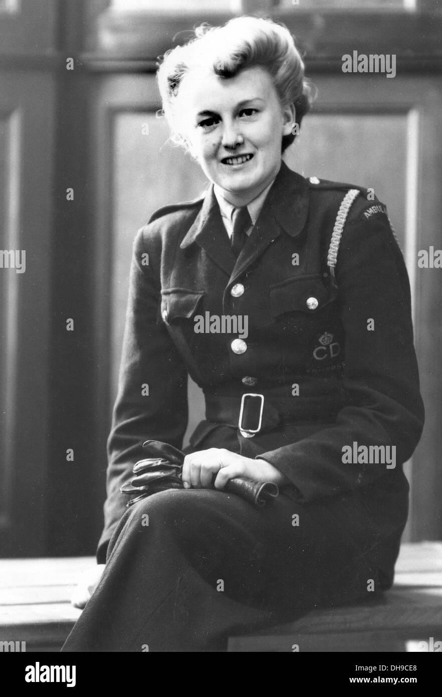 A WW2 Civil Defence Air Raid Protection unit Ambulance driver in uniform - Stock Image