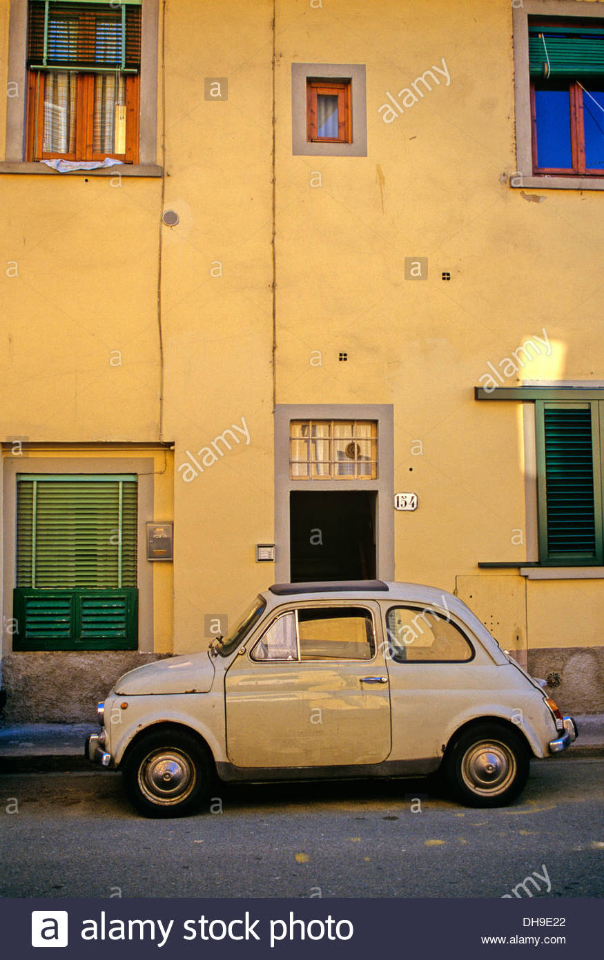 An original Fiat 500 in a back street in Florence, Italy - Stock Image