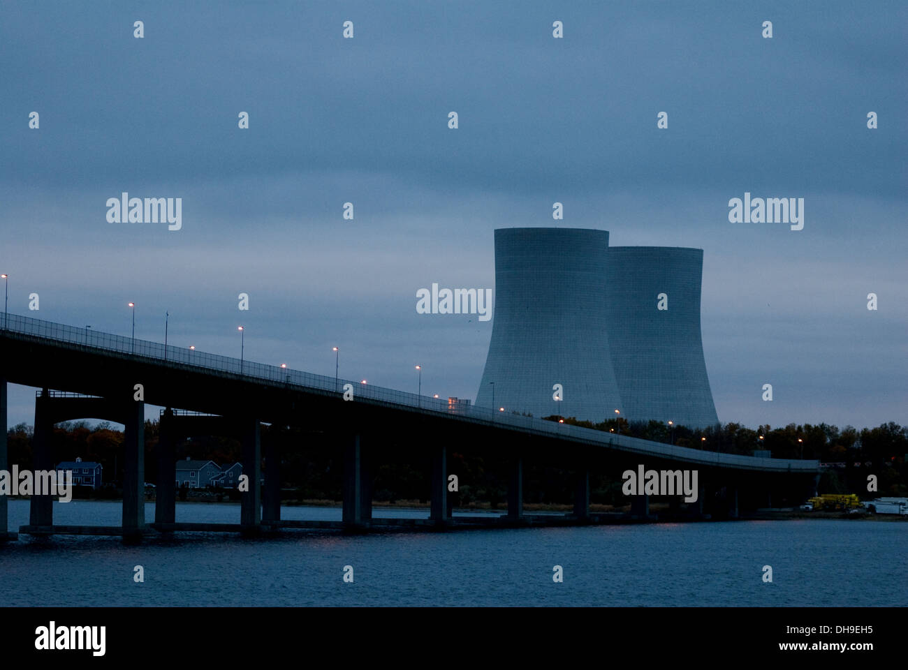 Power station cooling towers behind long bridge. - Stock Image