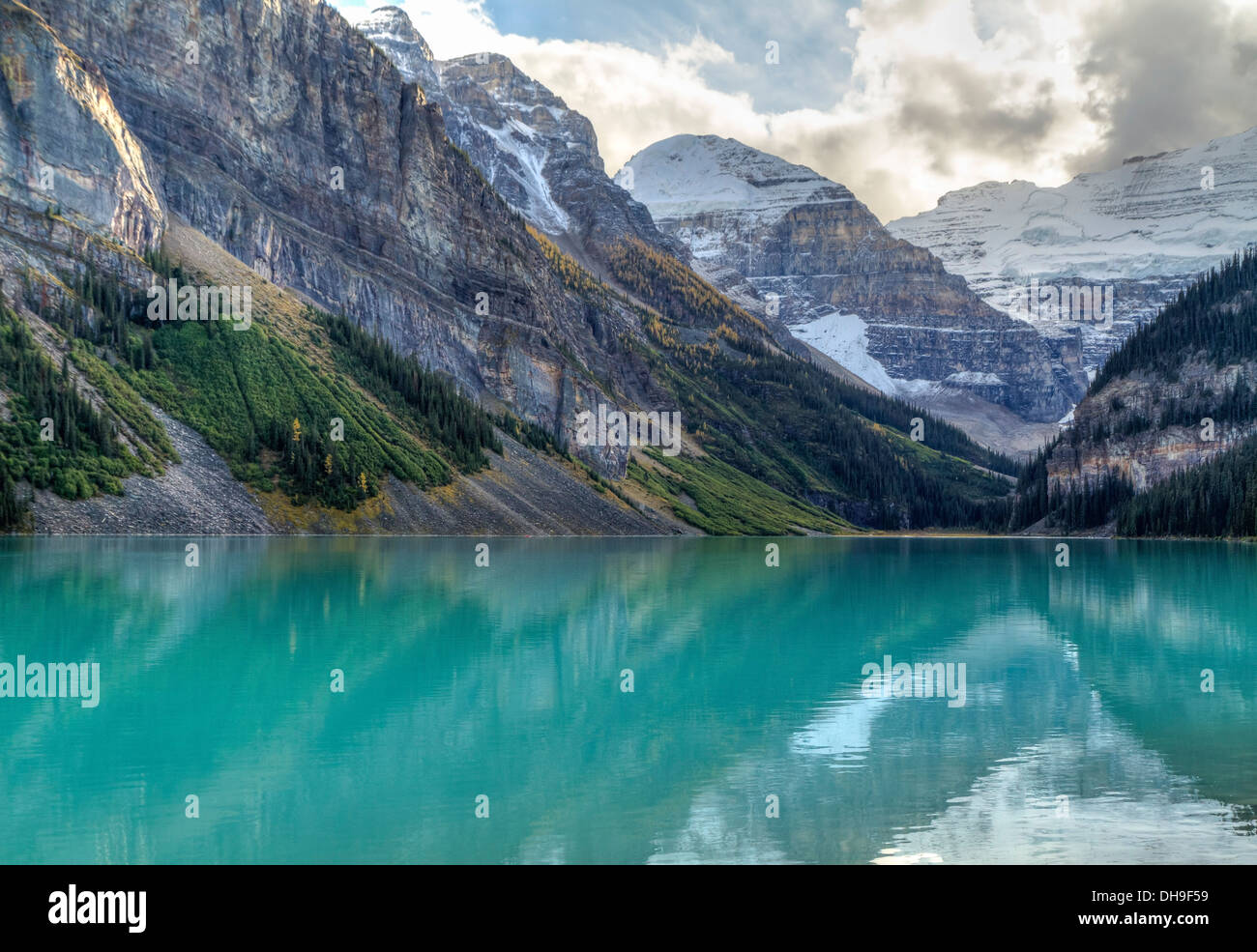 Mountains and glaciers reflected in the idyllic azure glacial waters of Lake Louise, Alberta, Canada Stock Photo