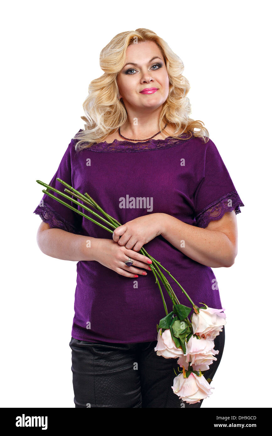 Blonde lady with a bouquet of flowers in her blouse shot in studio - Stock Image