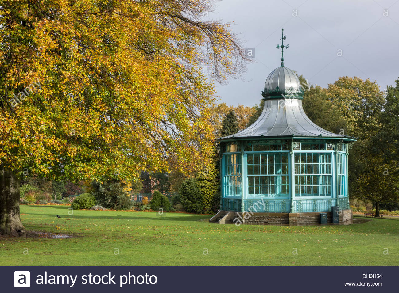 The bandstand at Weston Park, Sheffield with the trees in autumn colours - Stock Image
