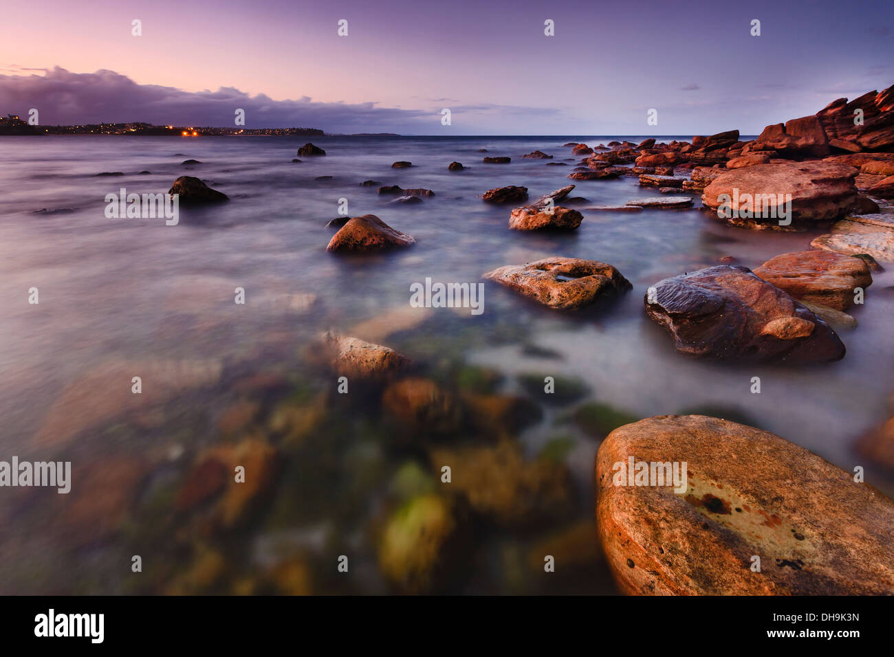 sydney australia manly shelly beach wet rocky stones at sunset transparent surf blurred waves with long exposure - Stock Image