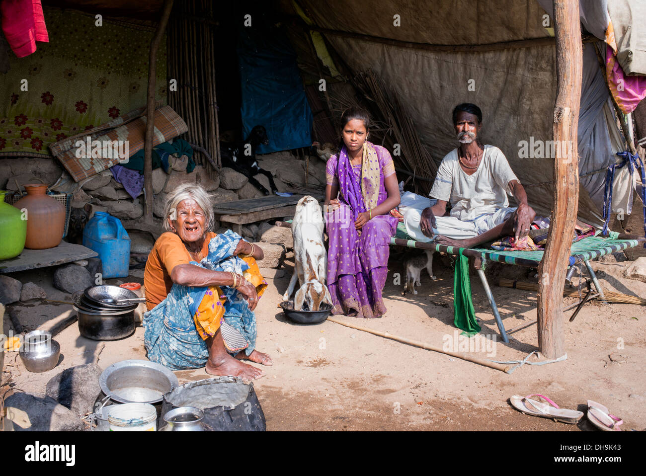 Lower caste Indian family sitting inside their bender / tent / shelter. Andhra Pradesh, India. - Stock Image