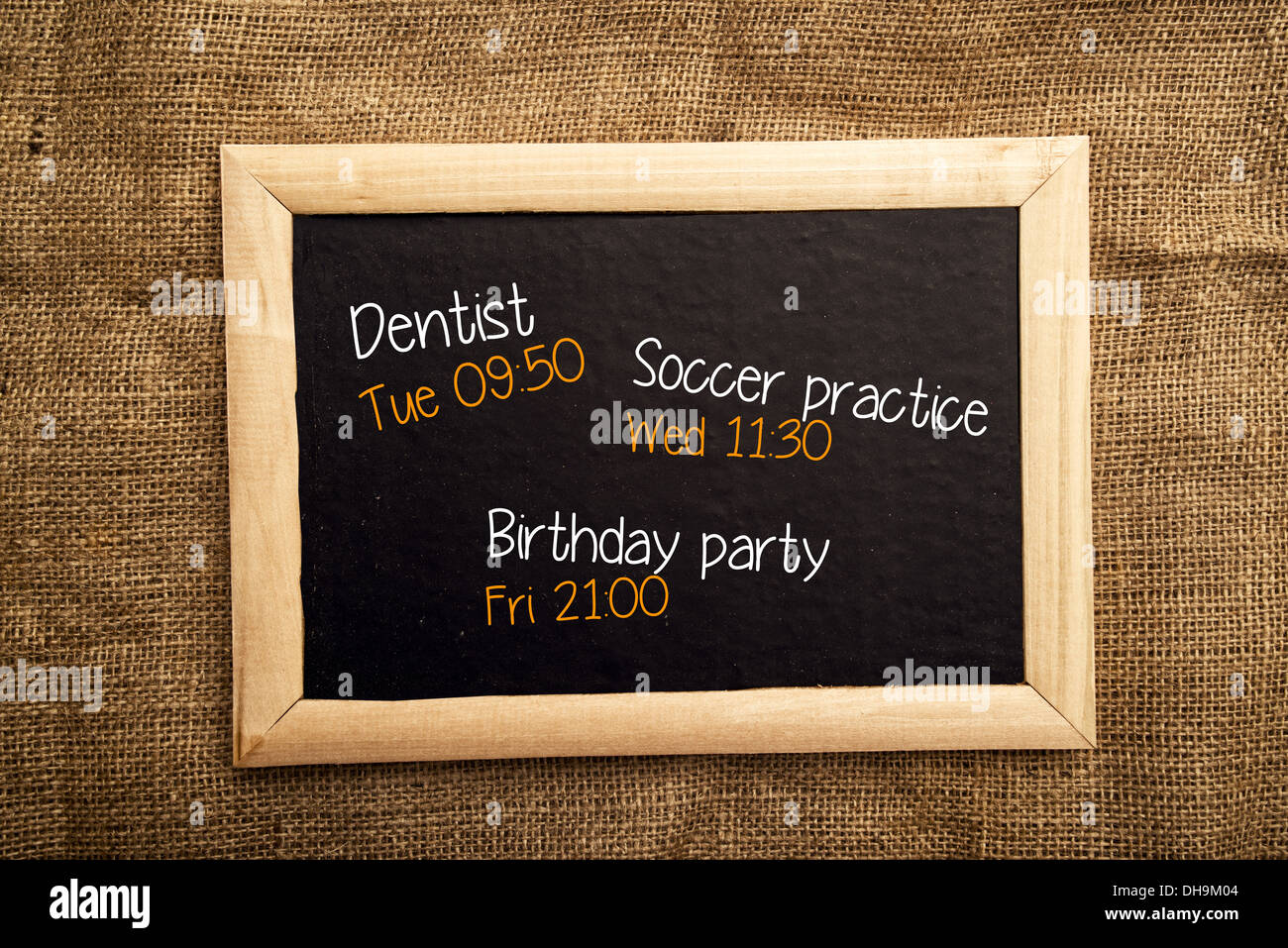 Organization board, personal notes on black message board - Stock Image