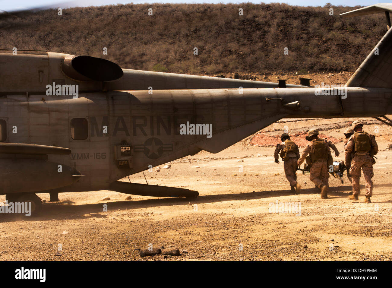 U.S. Marines with the 13th Marine Expeditionary Unit (MEU) litter carry a simulated causality to a CH-53E Super Stock Photo