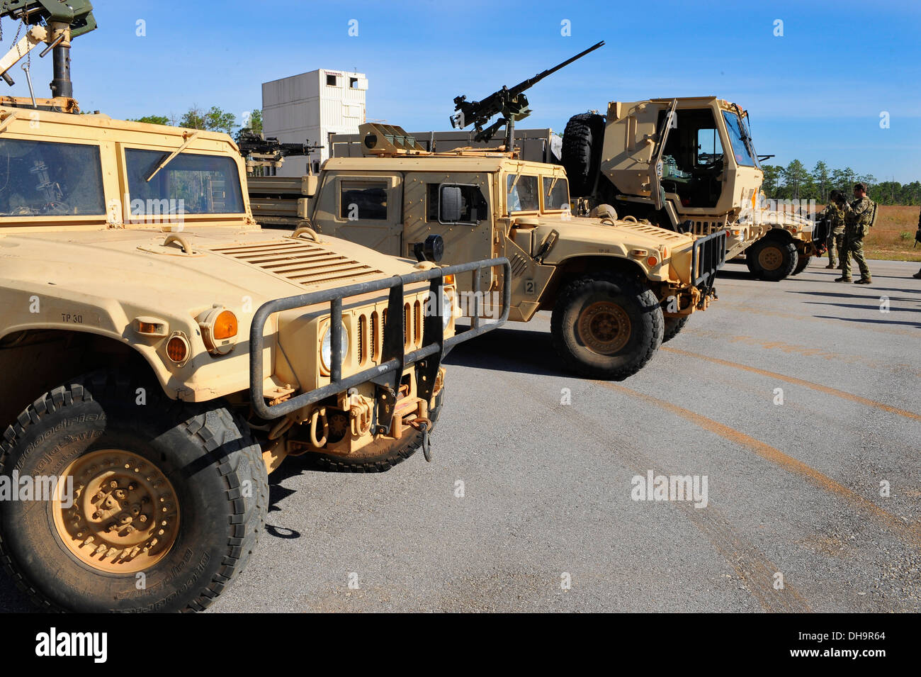 Humvees are parked on Eglin Range, Eglin Air Force Base, Fla., Oct. 29, 2013 prior to the tactical training exercise. Hurlburt Field instructors assisted and trained members of the army during a tactical training exercises. - Stock Image