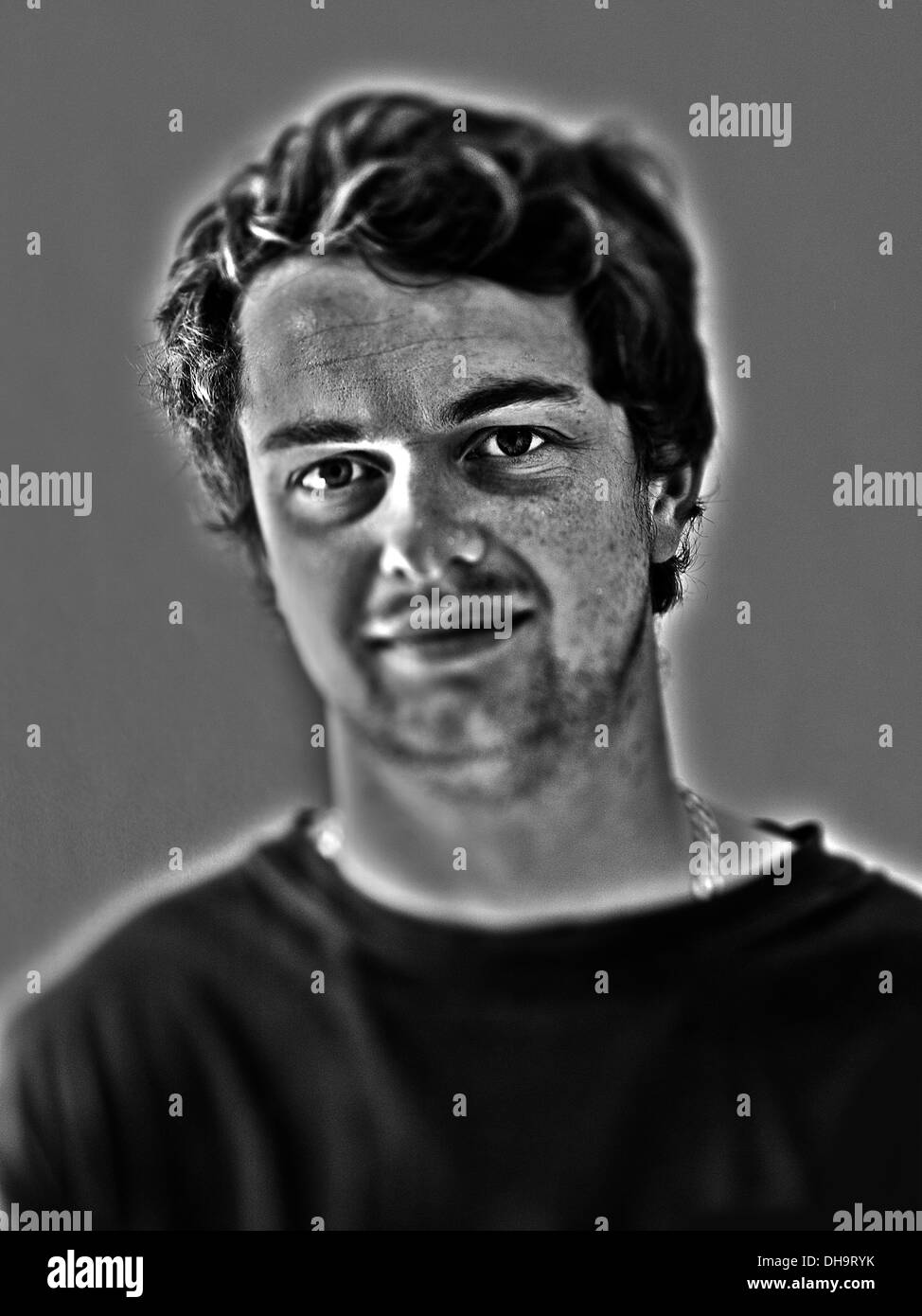 White European male age 25-30 photographed in black and white in a studio environment - Stock Image