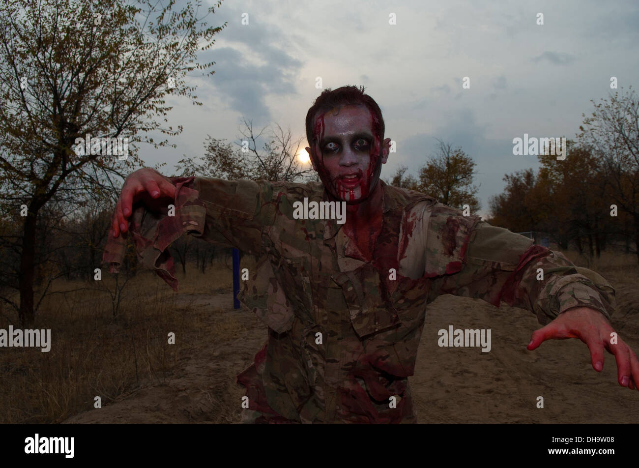 Capt. John Nussbaum demonstrates his zombie costume and acting skills during the 'zombie run' at Transit Center at Manas, Kyrgyzstan, Oct. 31, 2013. Nussbaum is a 376th Expeditionary Civil Engineer Squadron construction management officer deployed out of - Stock Image
