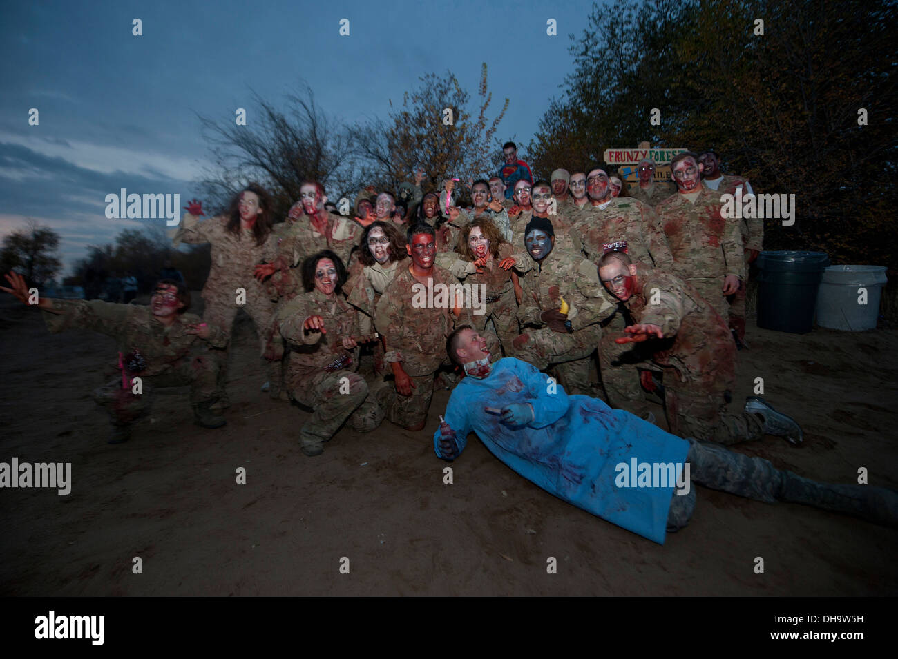 Dozens of residents of the Transit Center at Manas, Kyrgyzstan, dressed up to role-play for a 'zombie run' event Oct. 31, 2013. - Stock Image