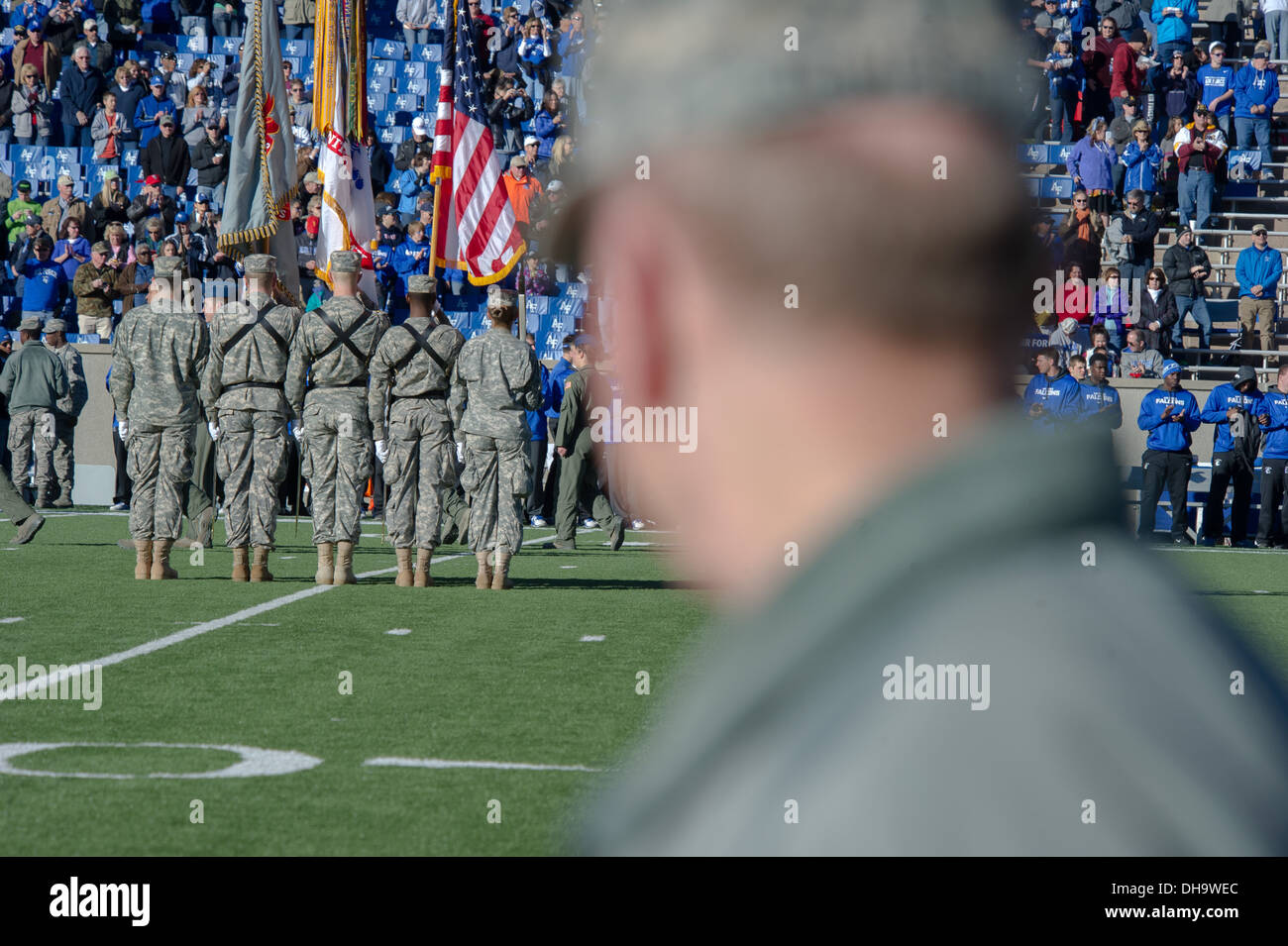 Chairman of the Joint Chiefs of Staff Gen. Martin E. Dempsey looks on as the flag detail marches on the field at Falcon Stadium - Stock Image