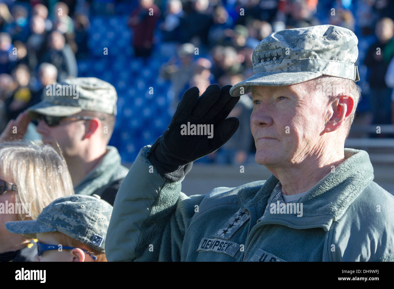 Chairman of the Joint Chiefs of Staff Gen. Martin E. Dempsey salutes at Falcon Stadium during an Air Force verses Army football - Stock Image