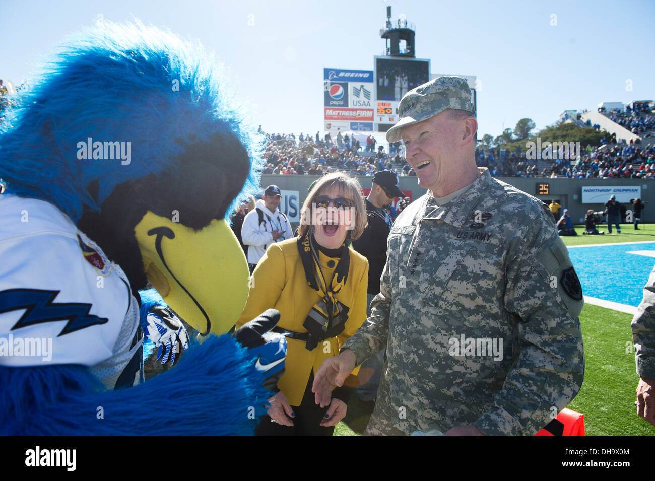 Chairman of the Joint Chiefs of Staff Gen. Martin E. Dempsey and his wife Mrs. Deanie meet the U.S. Air Force Academy mascot at - Stock Image