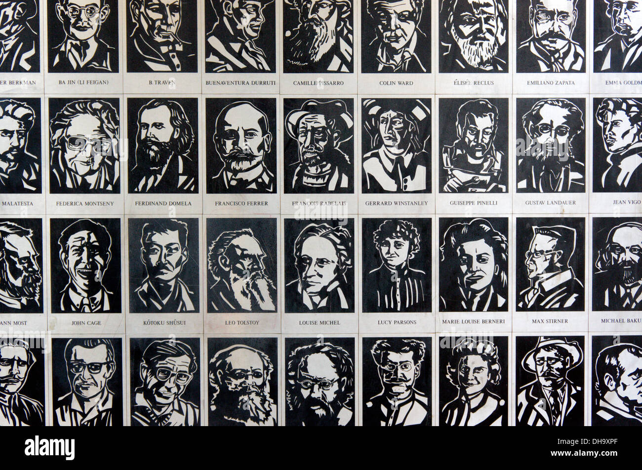Tiles showing radical writers and artists on the wall of Freedom Press anarchist publishers and bookshop in Whitechapel. - Stock Image