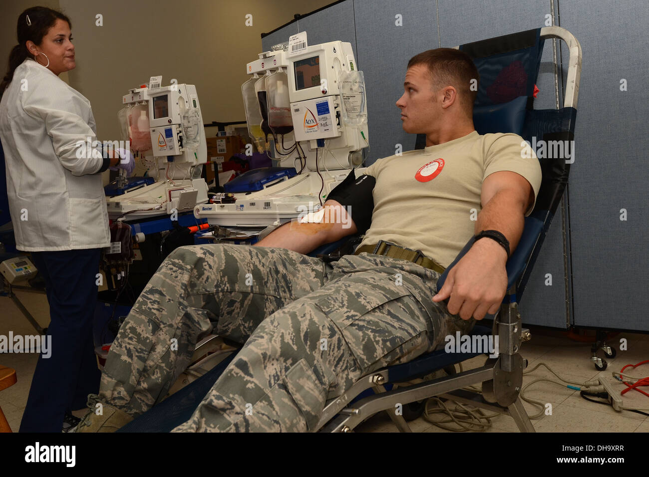 Kay Arroyo with the American Red Cross talks to U.S. Air Force Staff Sgt. Tyler Kellogg during the on-base blood drive at McEntire Joint National Guard Base of the South Carolina Air National Guard, Nov. 3, 2013. Kellogg, a fire team member with the 169th - Stock Image