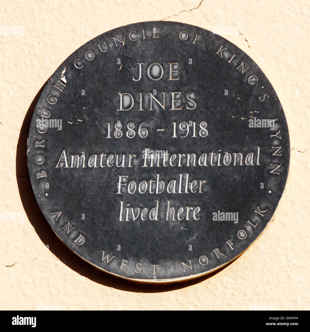 A plaque marks the house in King's Lynn lived in by the amateur international footballer Joe Dines. - Stock Image