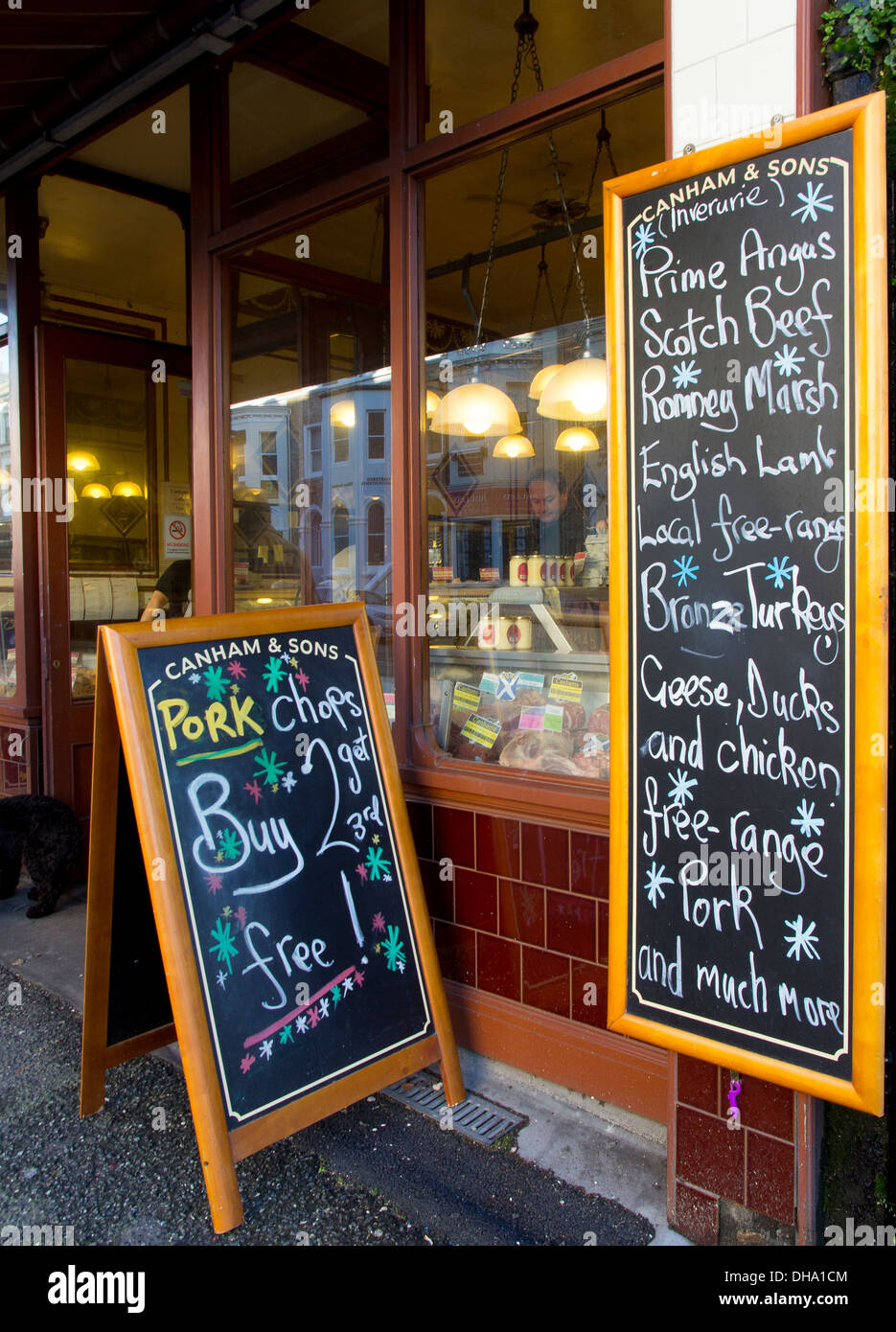 Blackboards outside Canham & Sons, a traditional butcher shop on Church Road, Brighton & Hove - Stock Image