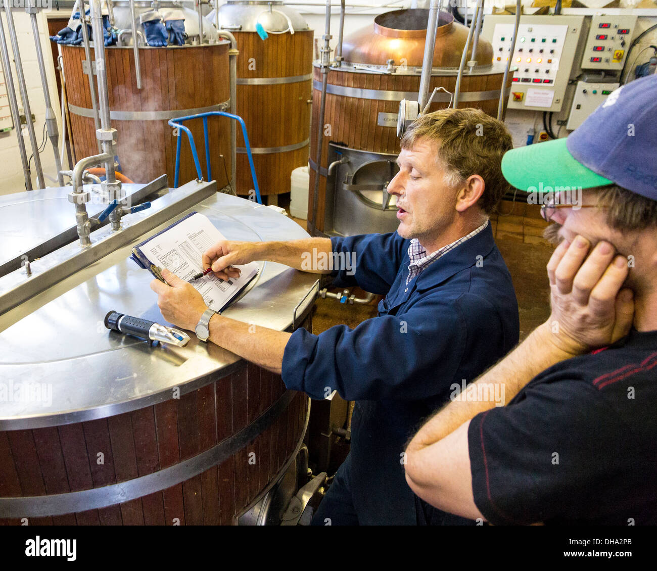 7 Sep 2012, Horsham, UK: Ian Burgess the Head Brewer at WJ King Brewery explaining the ale brewing process - Stock Image
