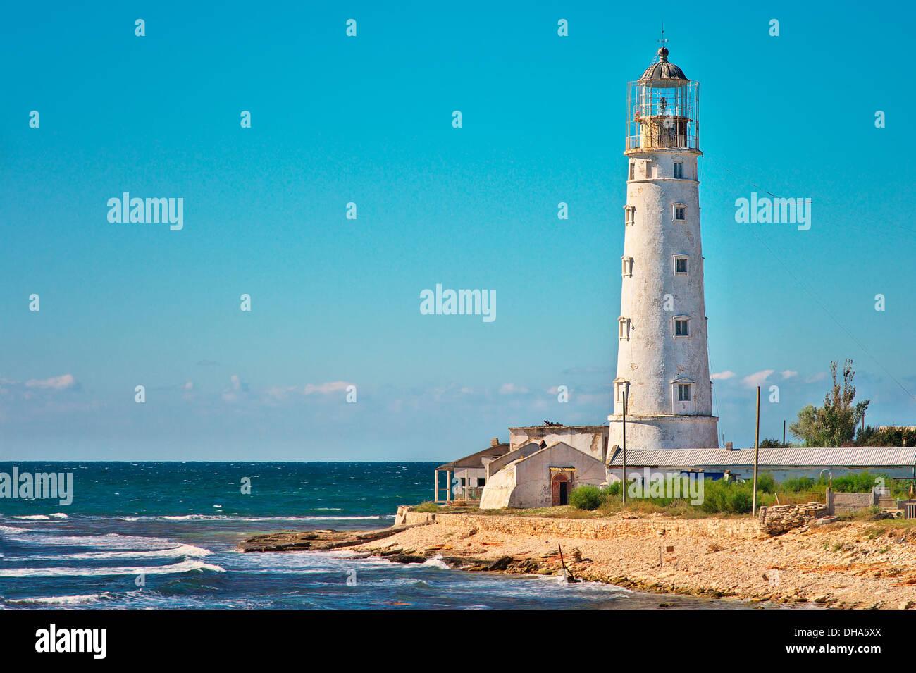Lighthouse Building on seaside with Blue Sky on Background Landmark of Tarhankut, Crimea, Ukraine Stock Photo