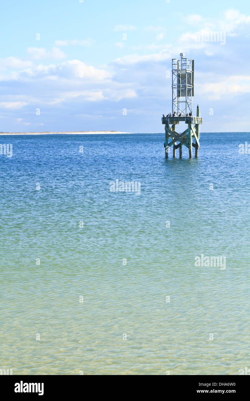 Channel marker in the calm, blue-green waters of Pensacola Bay off the Pensacola Naval Air Station - Stock Image