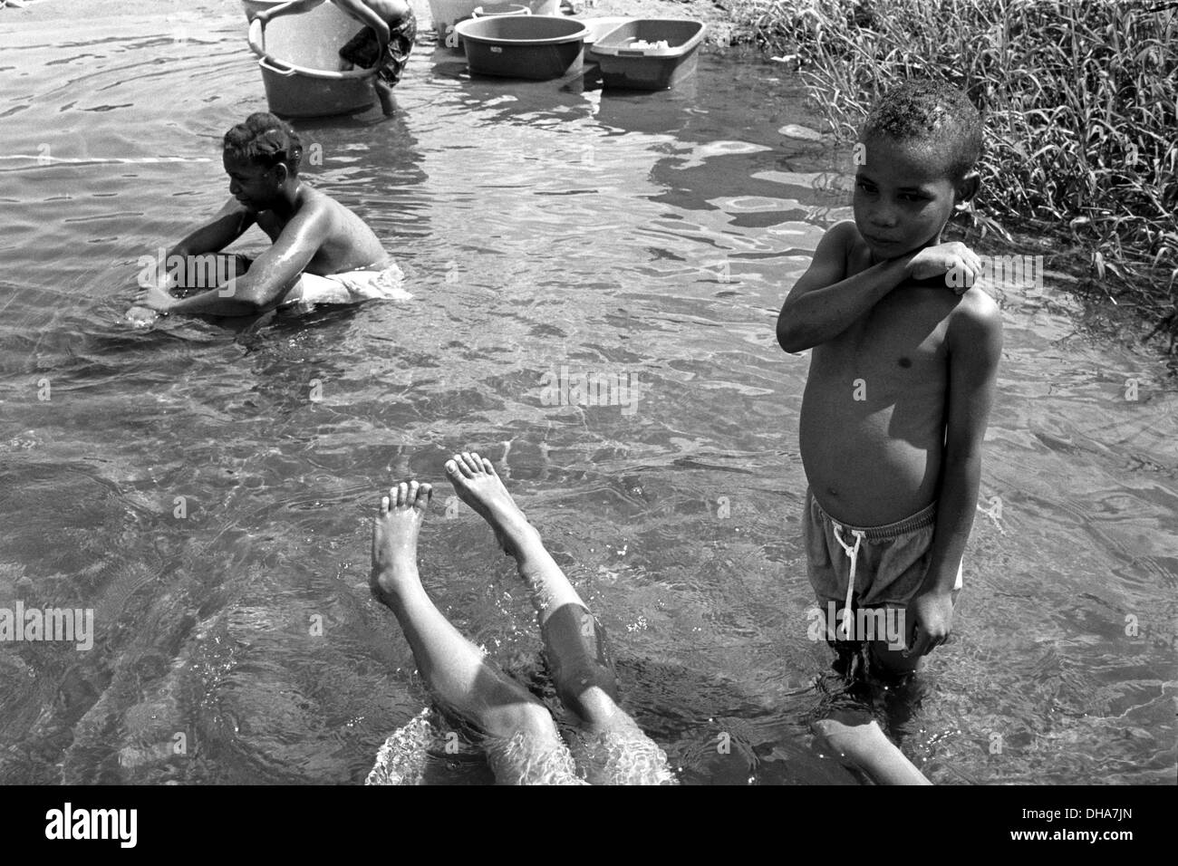 ipjr02222211feb 2000 Jantique Mozambiquechildren playing in a stream. During and after the heavy rains in Southern Africa and - Stock Image
