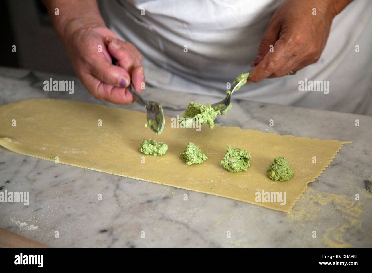 Woman Preparing Ravioli Fillings of Ricotta and Greens - Stock Image