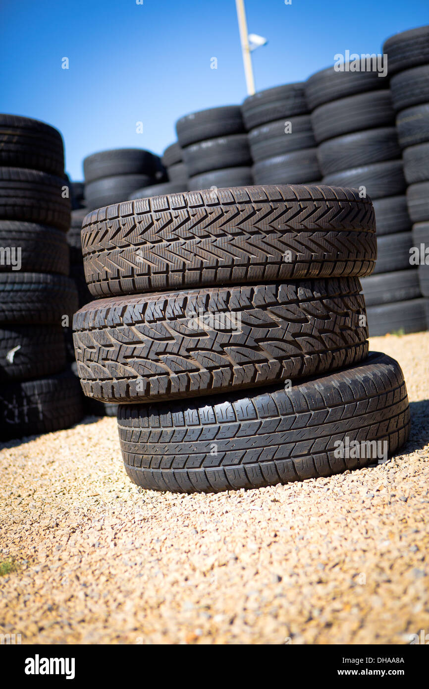 Stack of new tires for sale at a tire store. - Stock Image