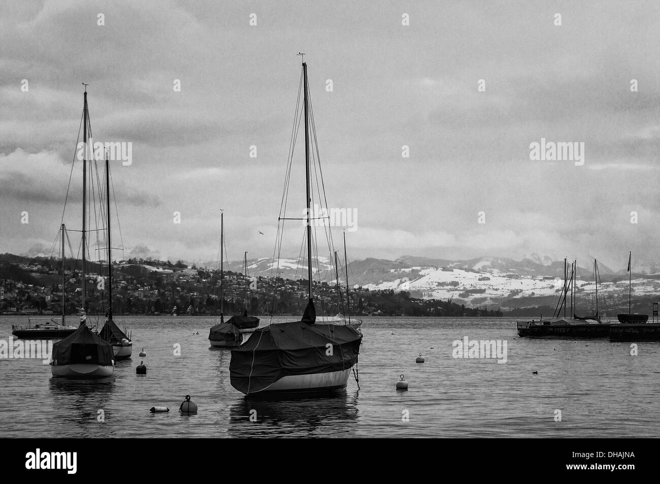Sail boats on Zurich lake in a winter day. Black and White version. - Stock Image