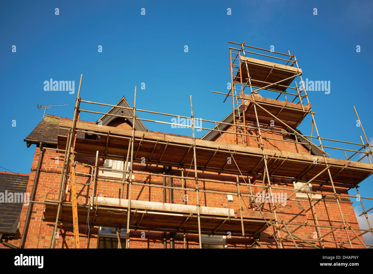 Scaffolding on the side of a house - Stock Image