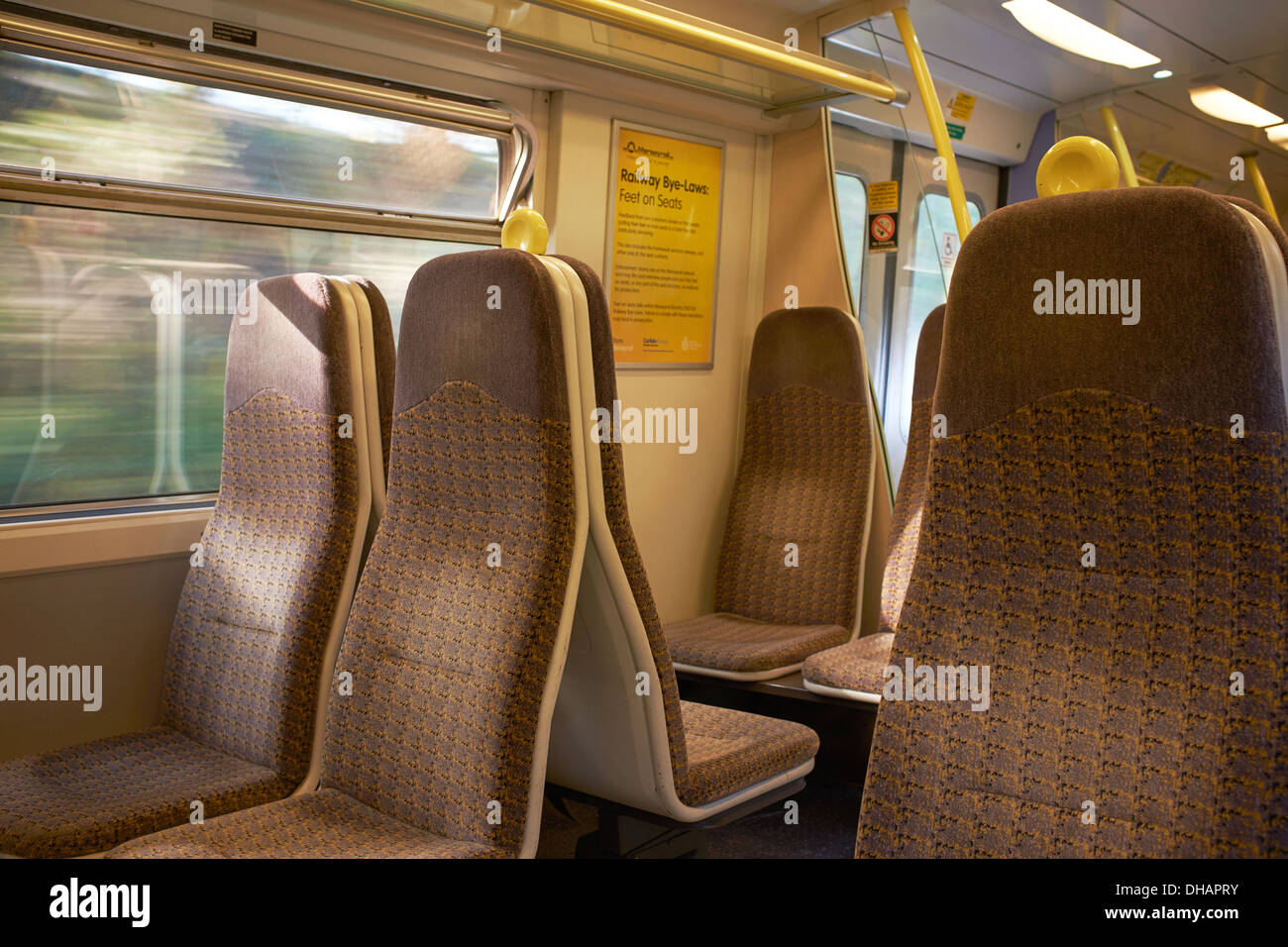 Interior of an empty carriage on a Merseyrail train - Stock Image