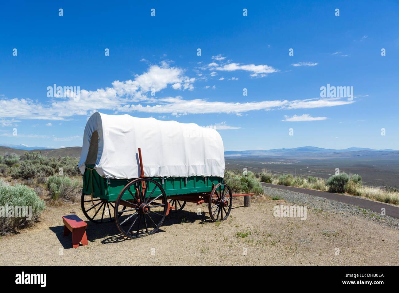 Covered wagon at the Wagon Encampment, National Historic Oregon Trail Interpretive Center, Baker, Oregon, USA - Stock Image
