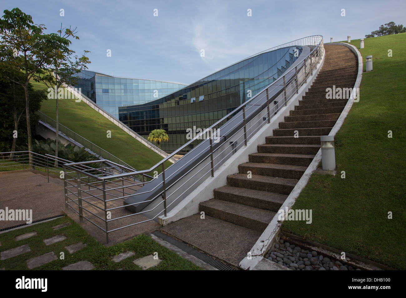 The Nanyang Technology University - School of Art, Design and Media building was conceived as natural extensions of the earth - Stock Image