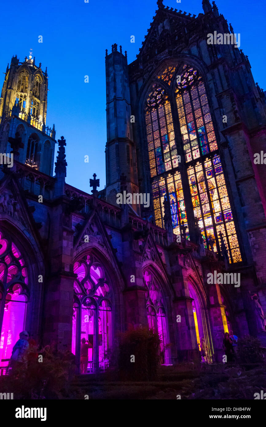 Dom Church and Dom Tower of Utrecht. Domkerk and Domtoren. St. Martin's Cathedral. Seen from the Pandhof cloisters at night. - Stock Image