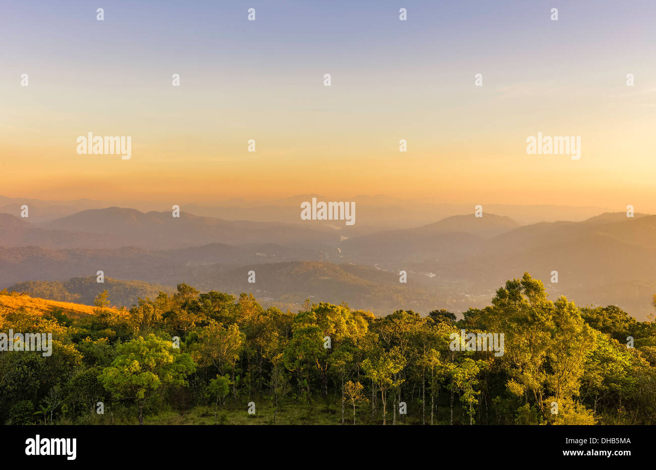 The cardamom Hills at sunset and the lake on the horizon at Periyar wildlife sanctuary in Kerala, India. - Stock Image