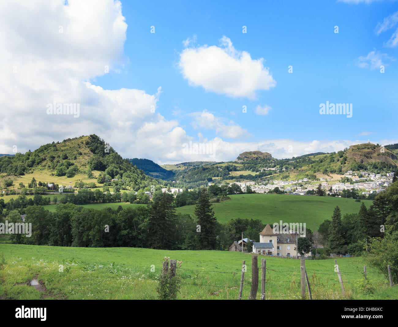 Three of the hills (puy) remnants of a vast extinct volcano surround the town in Parc Naturel Regional des Volcans d'Auvergne - Stock Image