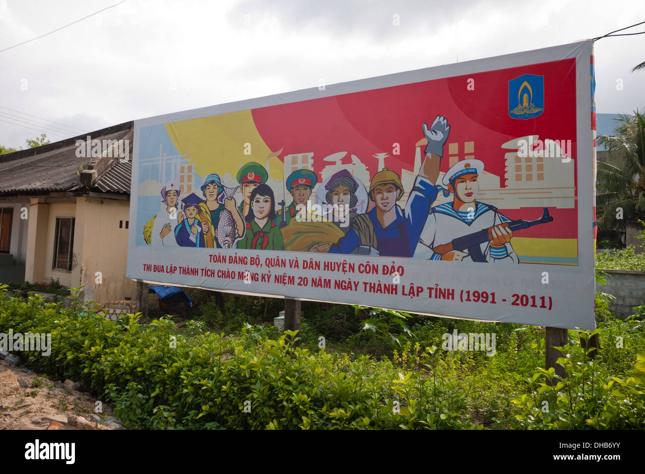 A Communist Party of Vietnam sign in Con Son Town, Con Son Island, Con Dao Islands, Vietnam. - Stock Image