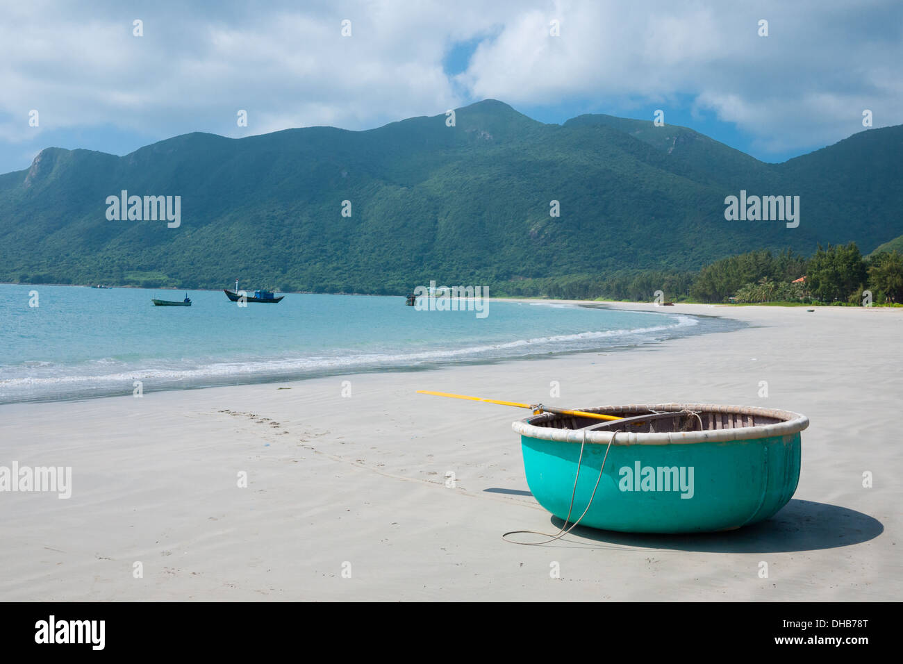 A view of a turquoise, circular rowboat on An Hai Beach on Con Son Island, one of the Con Dao Islands in Vietnam. - Stock Image