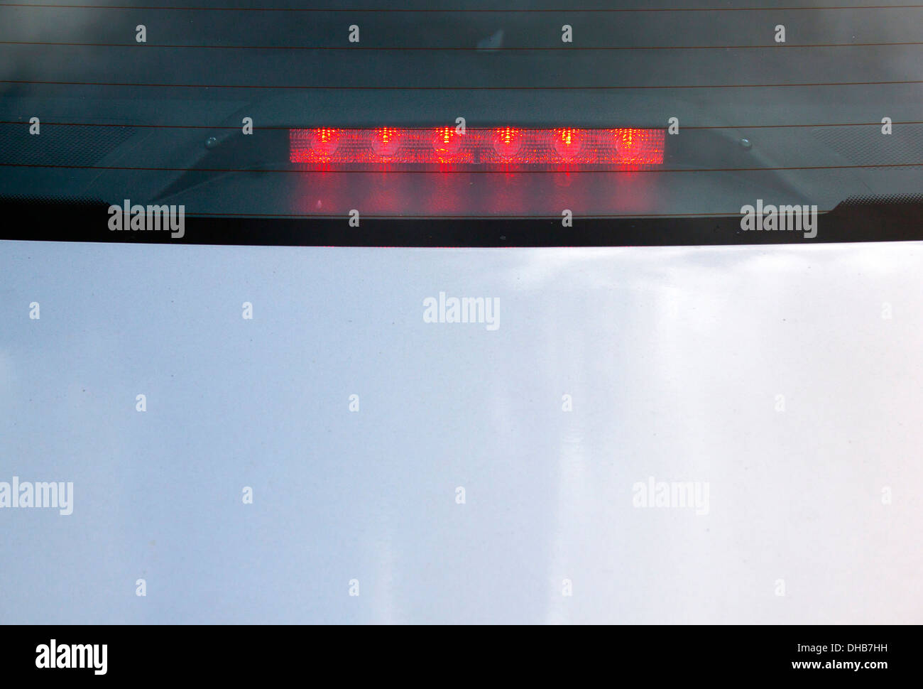 view of red LED stop light on back of automobile - Stock Image