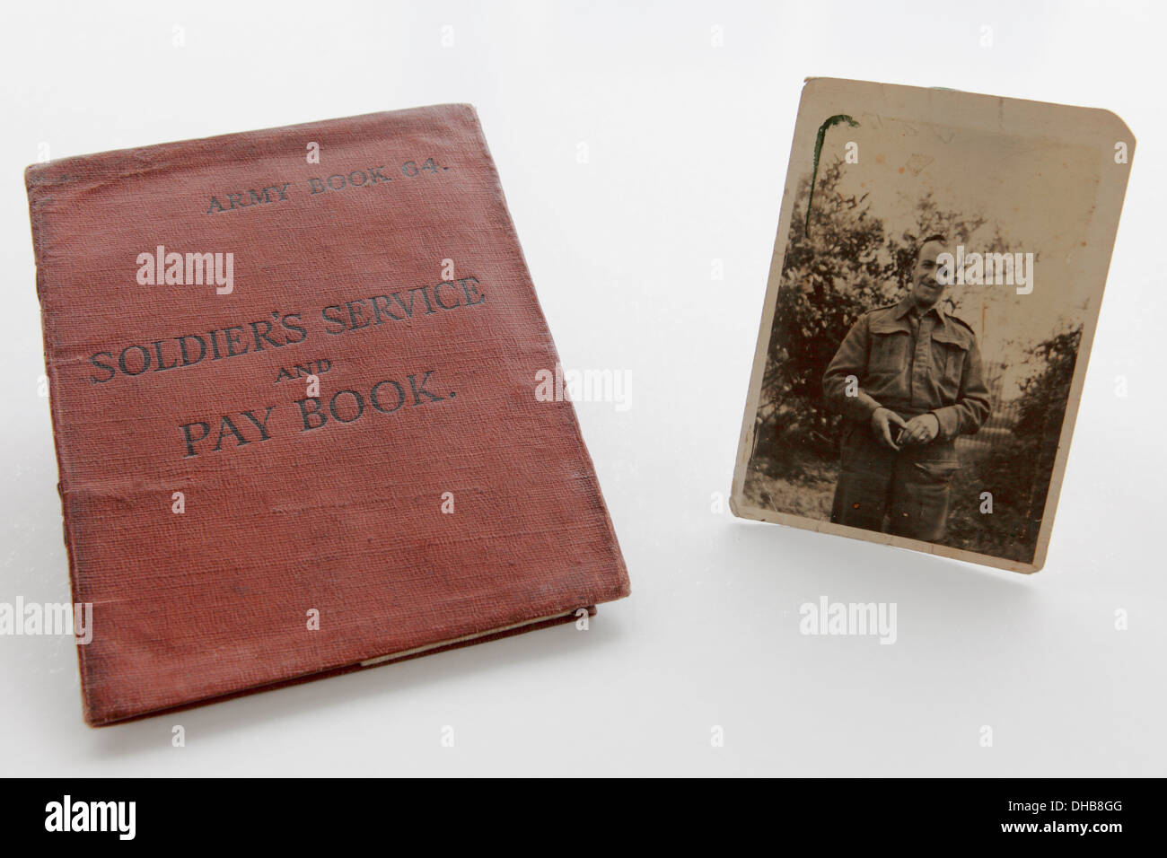 Photograph of WWII soldier Mr.Thomas Henry Wheeler alongside his Army Book 64 Soldier`s Service and Pay Book. - Stock Image