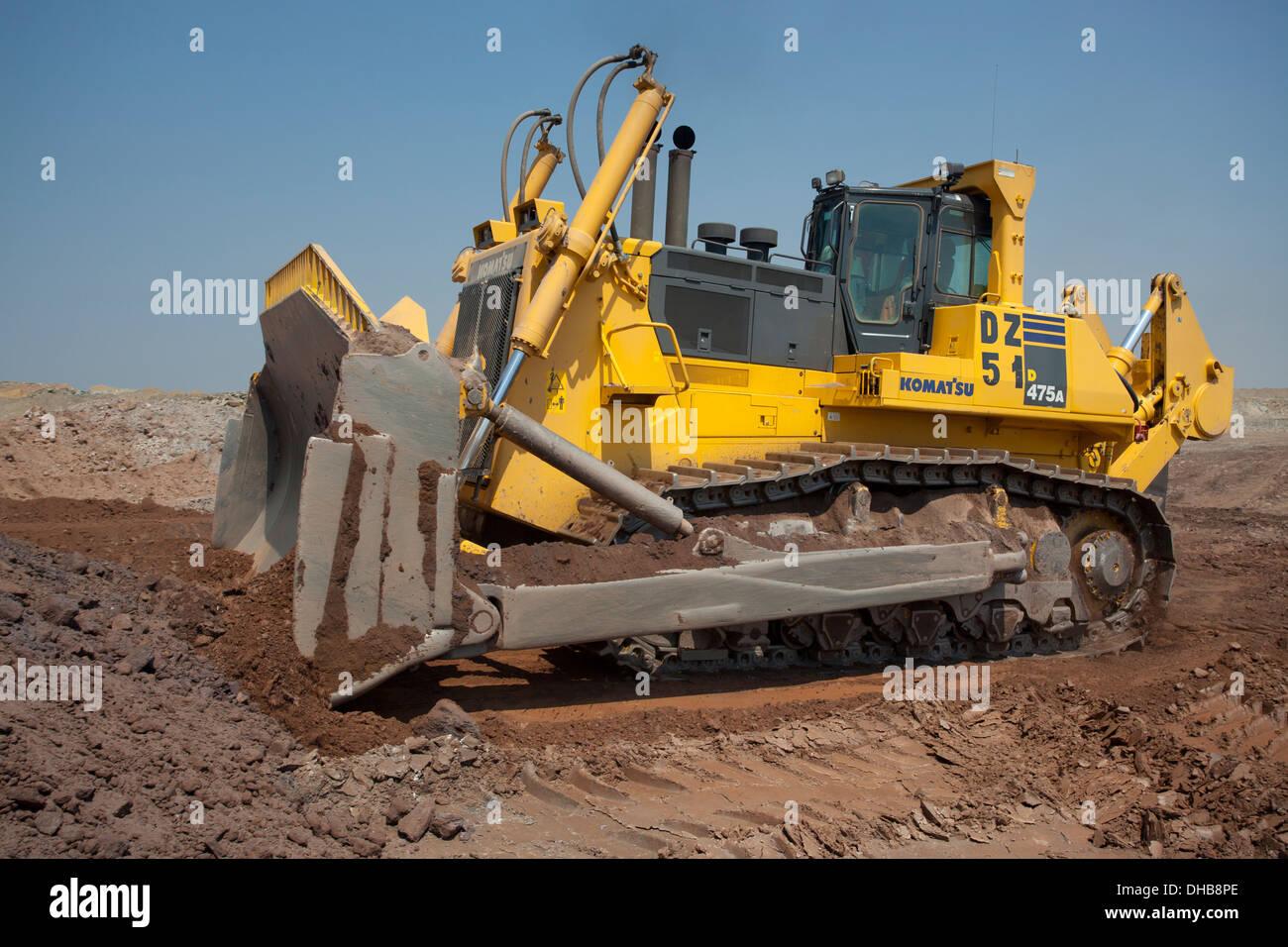 A large yellow Komatsu D475A Crawler Tractor dozer bulldozer in action, Zambia - Stock Image