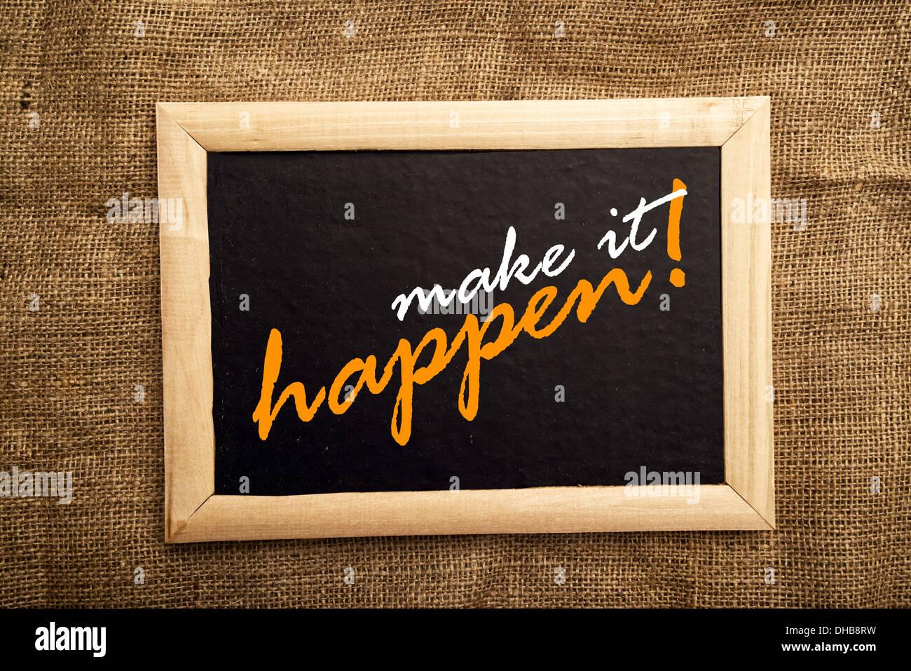 make it happen, motivational message on blackboard. - Stock Image