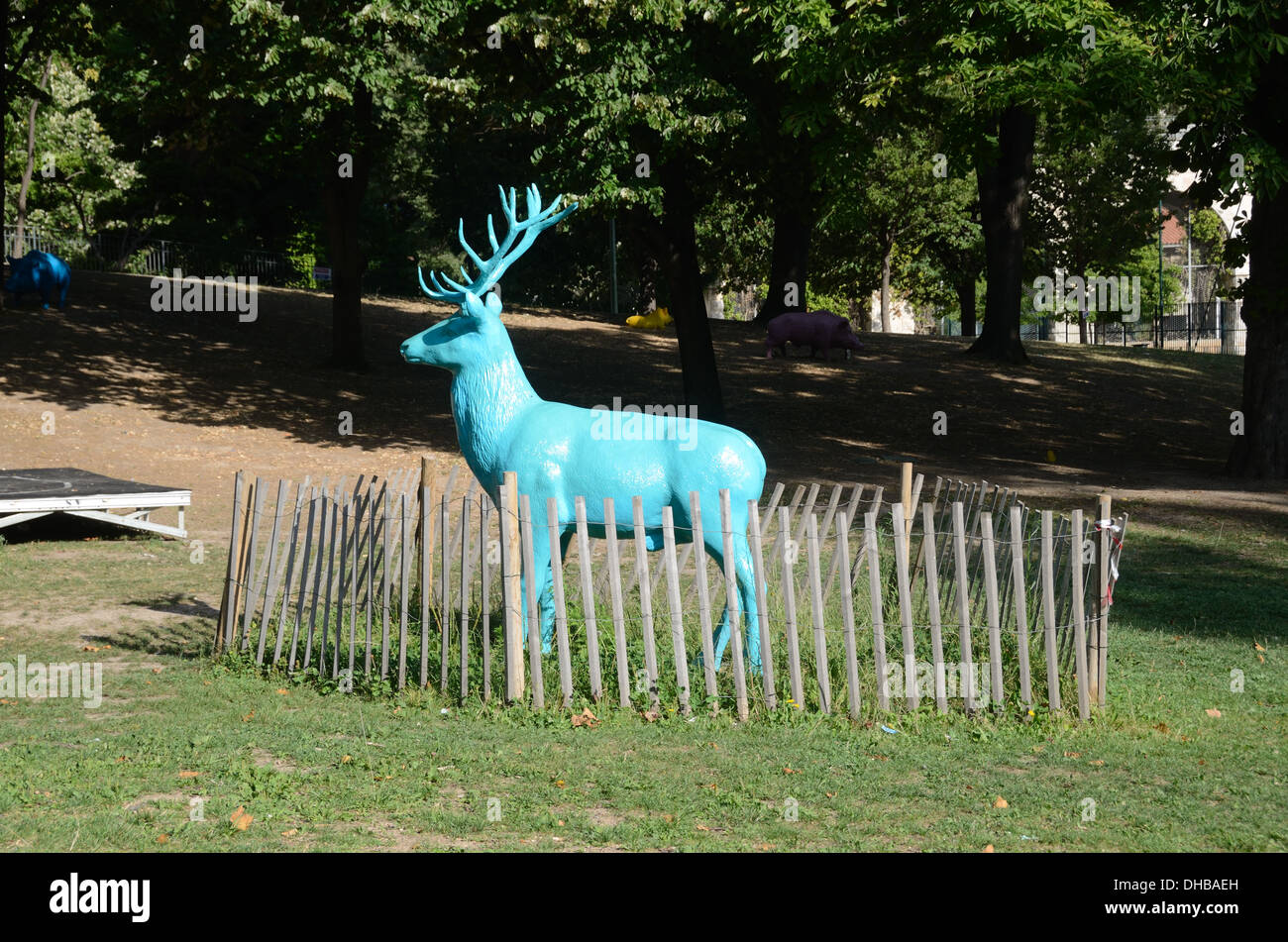 Fenced in Blue Plastic Resin Life-Size Deer at Marseille Funny Zoo France - Stock Image