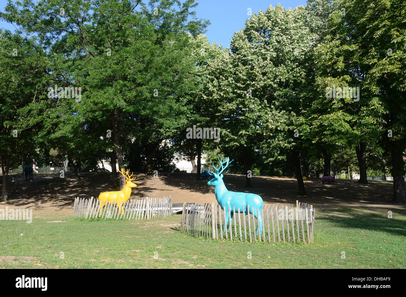 Fenced in Plastic Resin Deer at Marseille Funny Zoo France - Stock Image