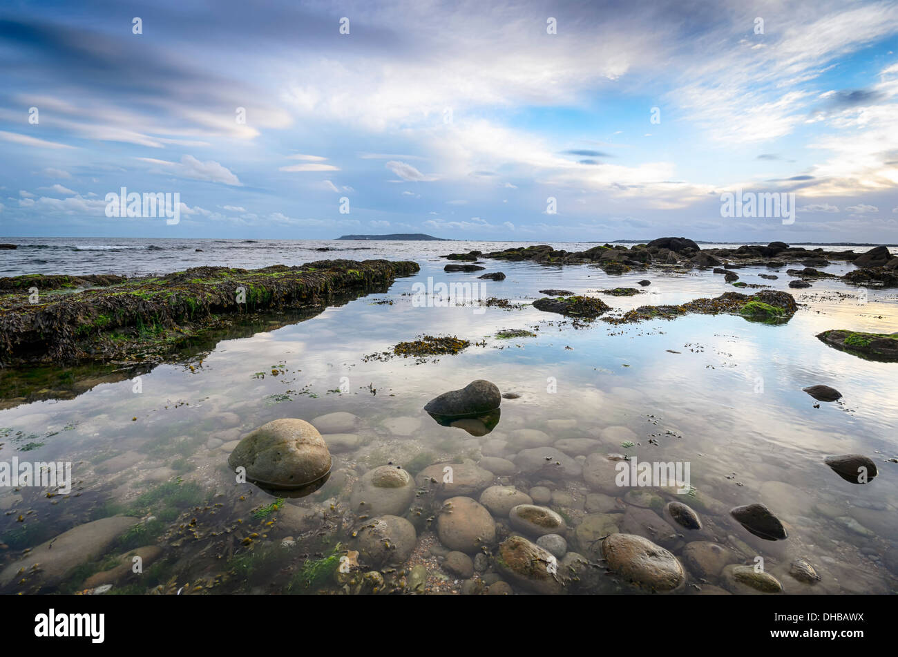 The beach at Osmington Mills near Weymouth in Dorset with the Isle of Portland on the horizon - Stock Image
