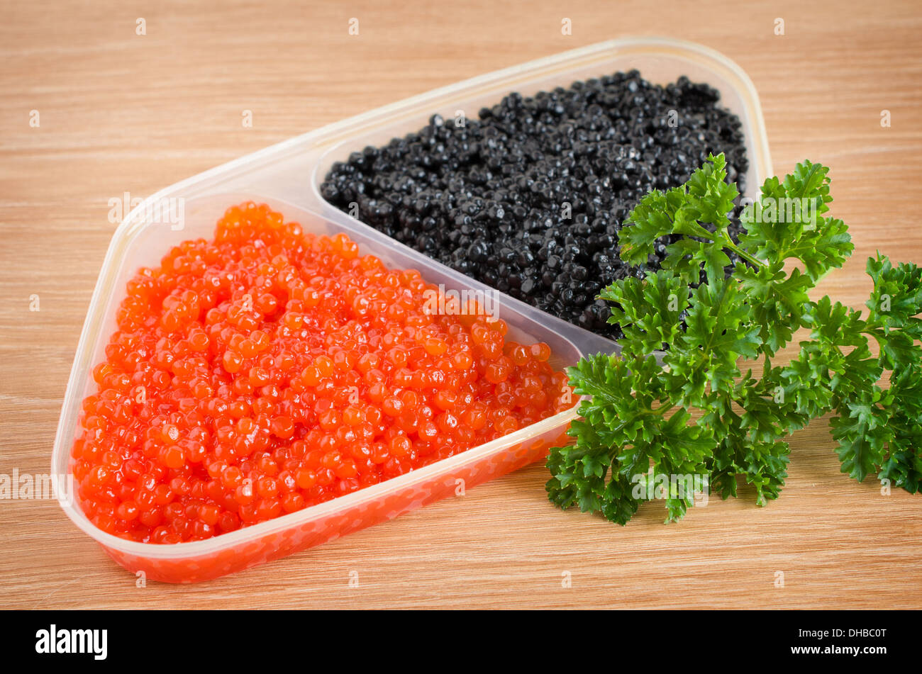 red and black caviar is in a serving plate - Stock Image