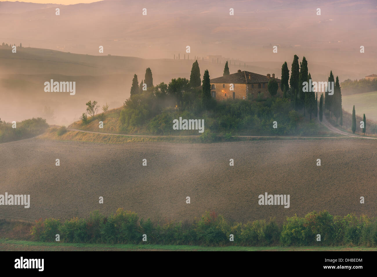 Famous Podere Belvedere in morning light, in the heart of the Tuscany, near San Quirico in de Val d'Orcia valley - Stock Image