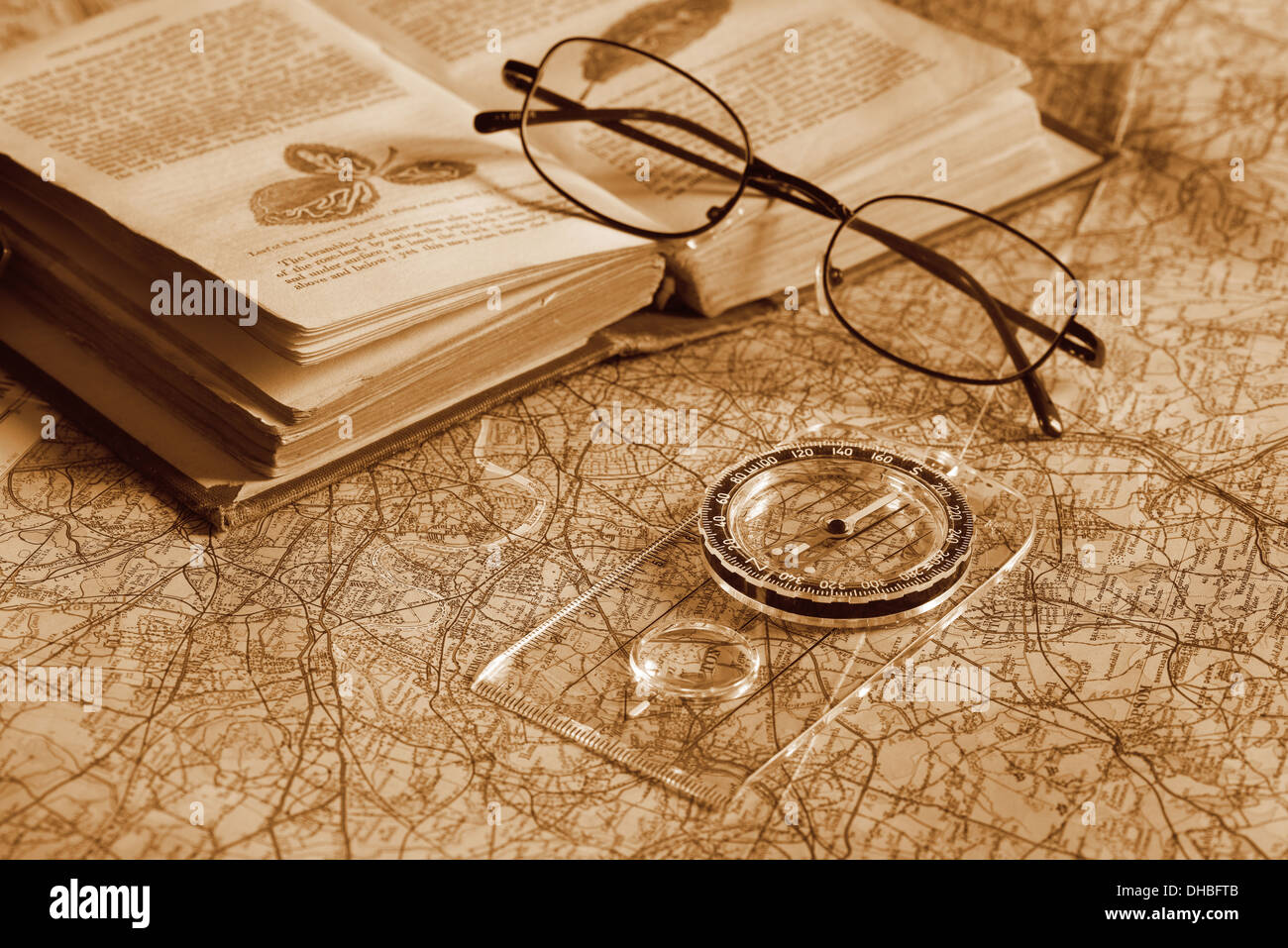 classic compass on colorful map preparing for journey with lots of hills steep valleys - Stock Image