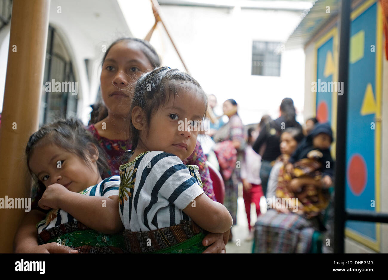 Mother and her twin daughters in Panajachel, Solola, Guatemala. - Stock Image